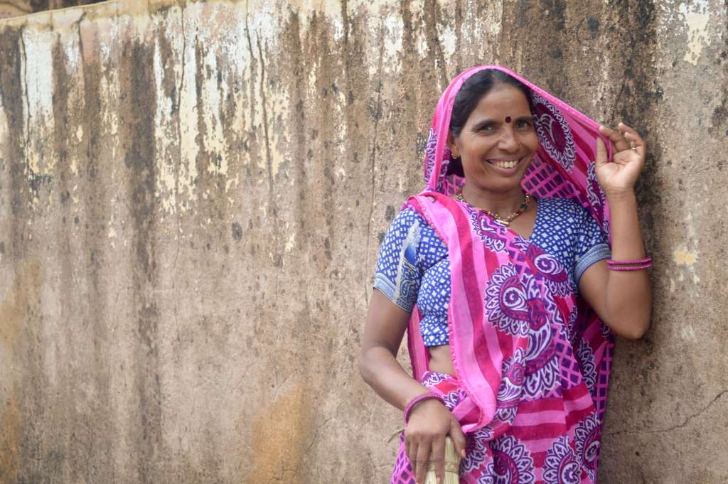 Portrait of a beautiful smiling Indian lady in a pink sari