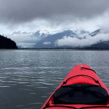 Sea kayaking surrounded by glaciers and mountains