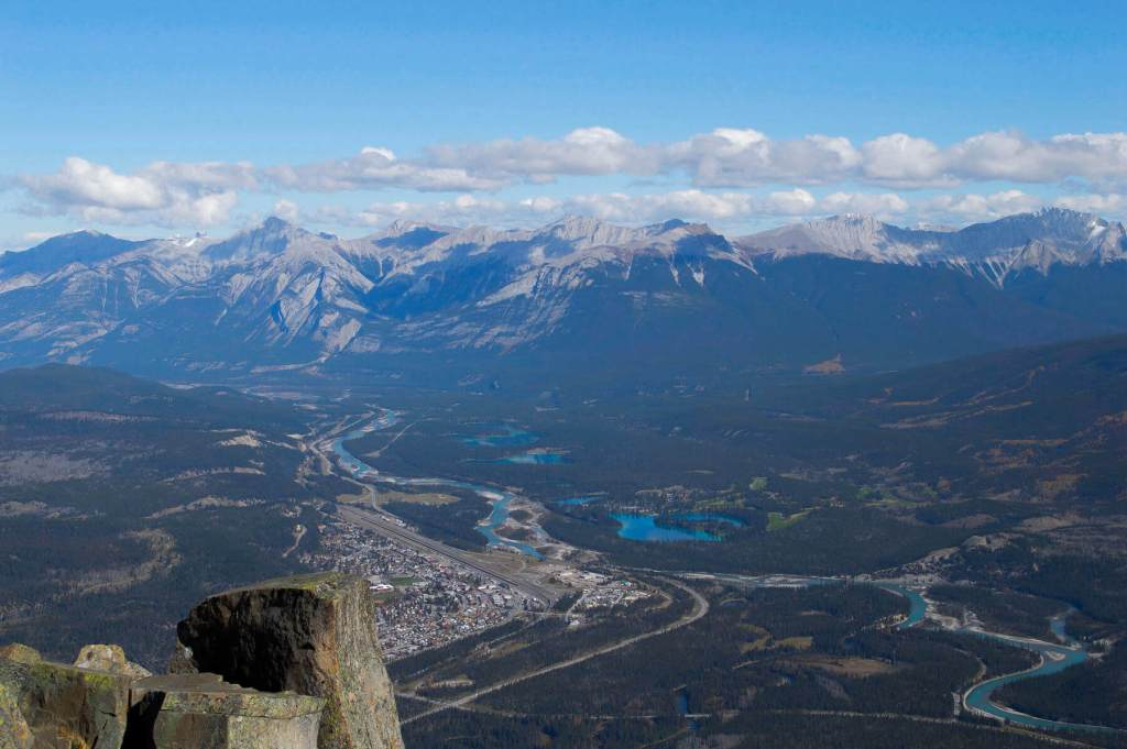 View of rockies and Jasper town centre from top of Mountain