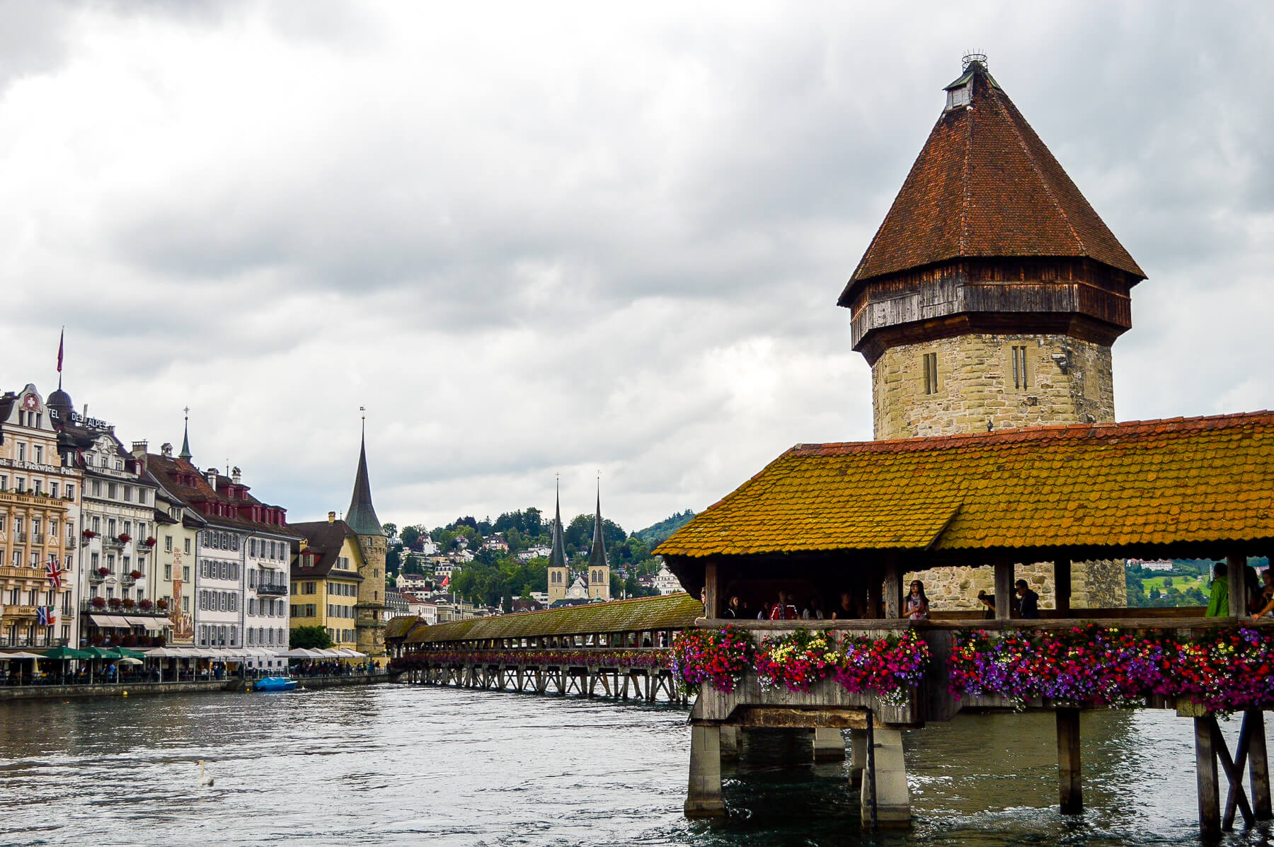 old bridge covered in flowers, in lucerne, switzerland