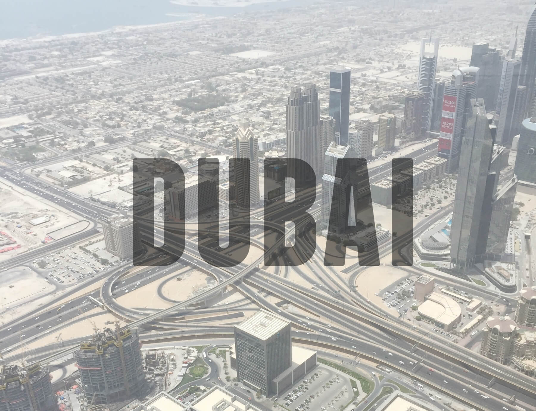 View from the top of the Burj Khalifa with text overlay - Dubai