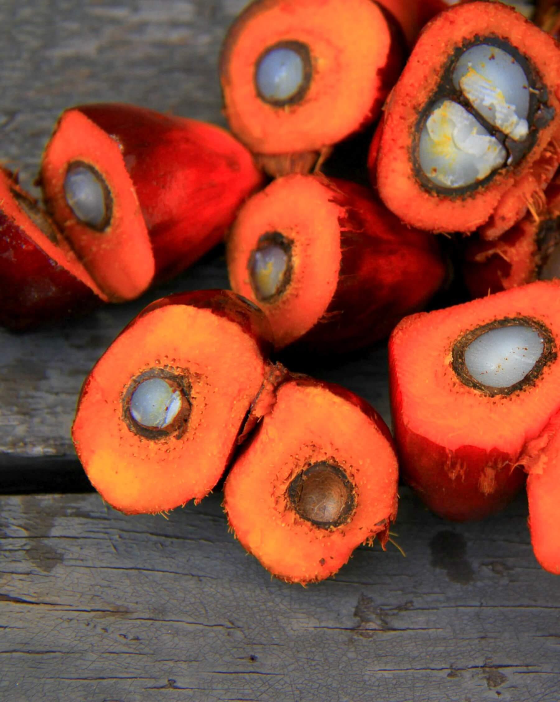 Pile of cut open Palm Oil Fruit