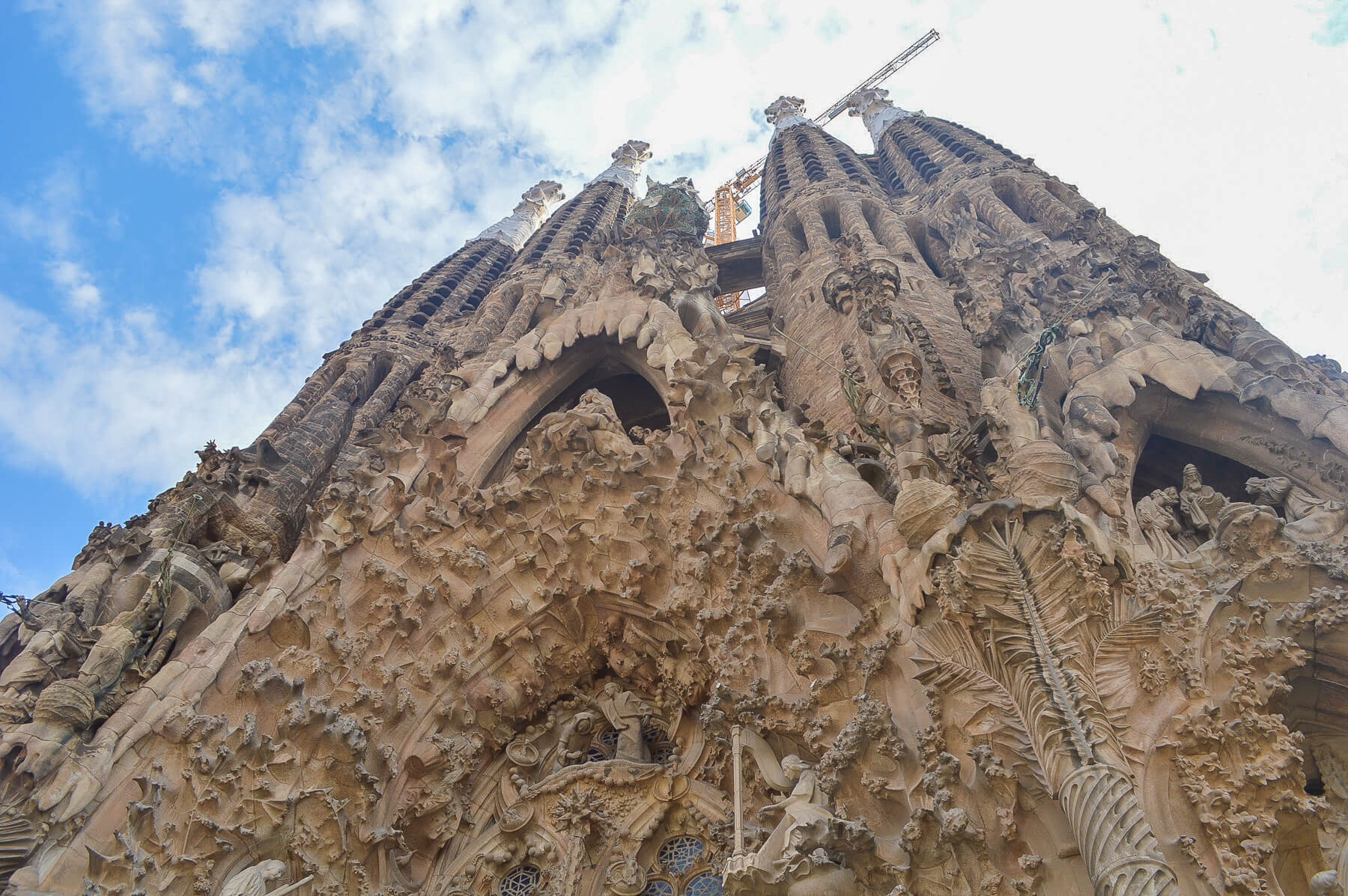 Up angle of huge textured cathedral in Barcelona - Sagrada Familia