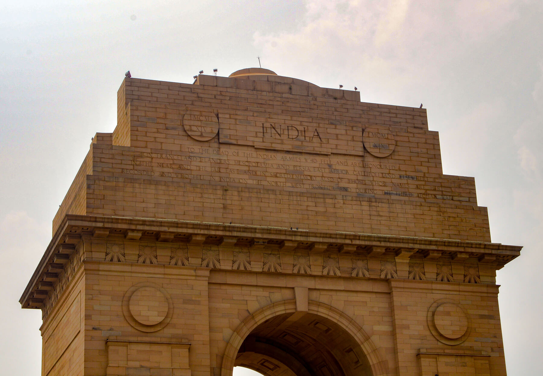 """Golden Archway with """"India"""" carved in the top"""