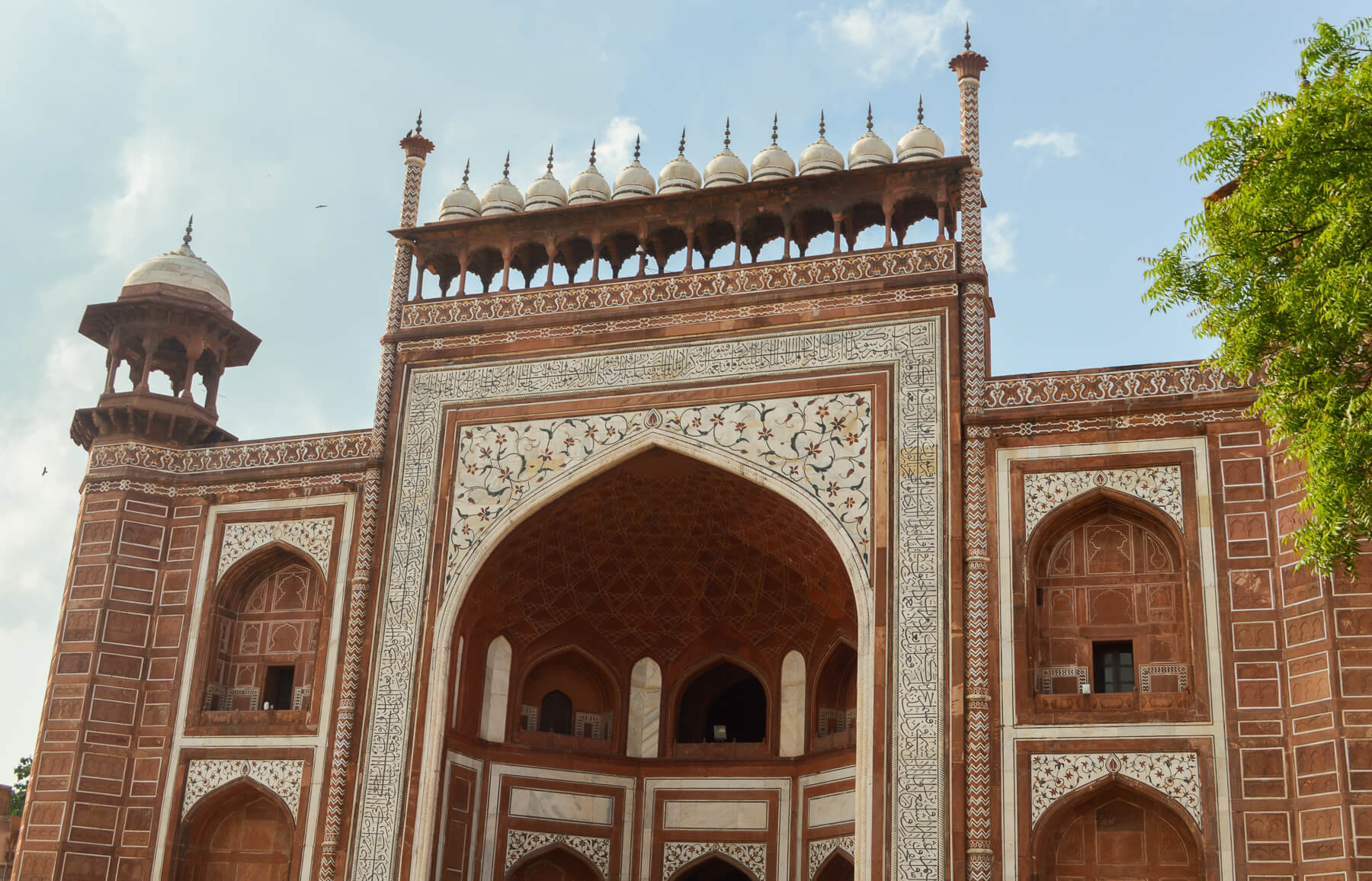 The terracotta entrance to the Taj Mahal, detailed archways and carvings