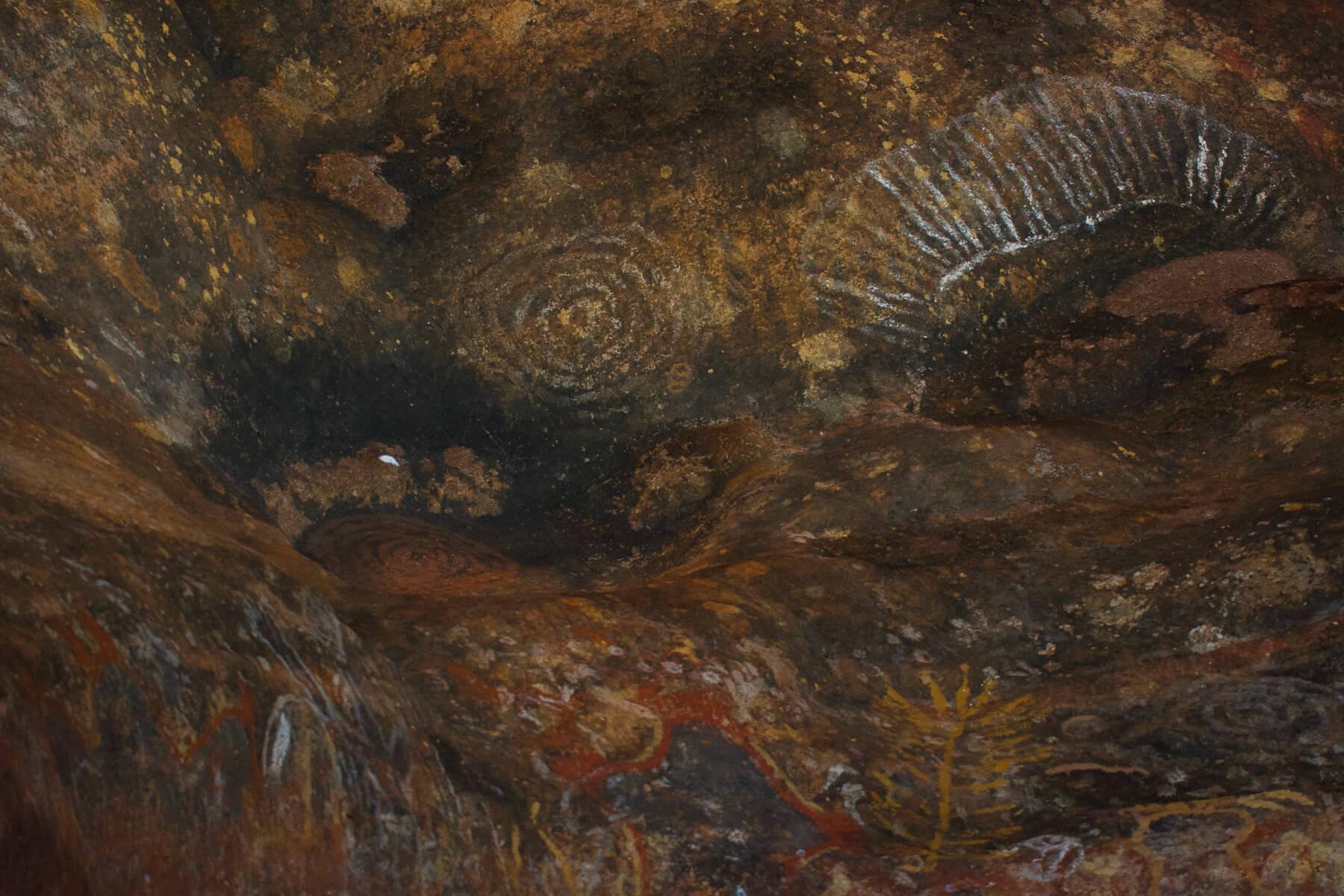 Aboriginal Paintings inside a cave of Uluru