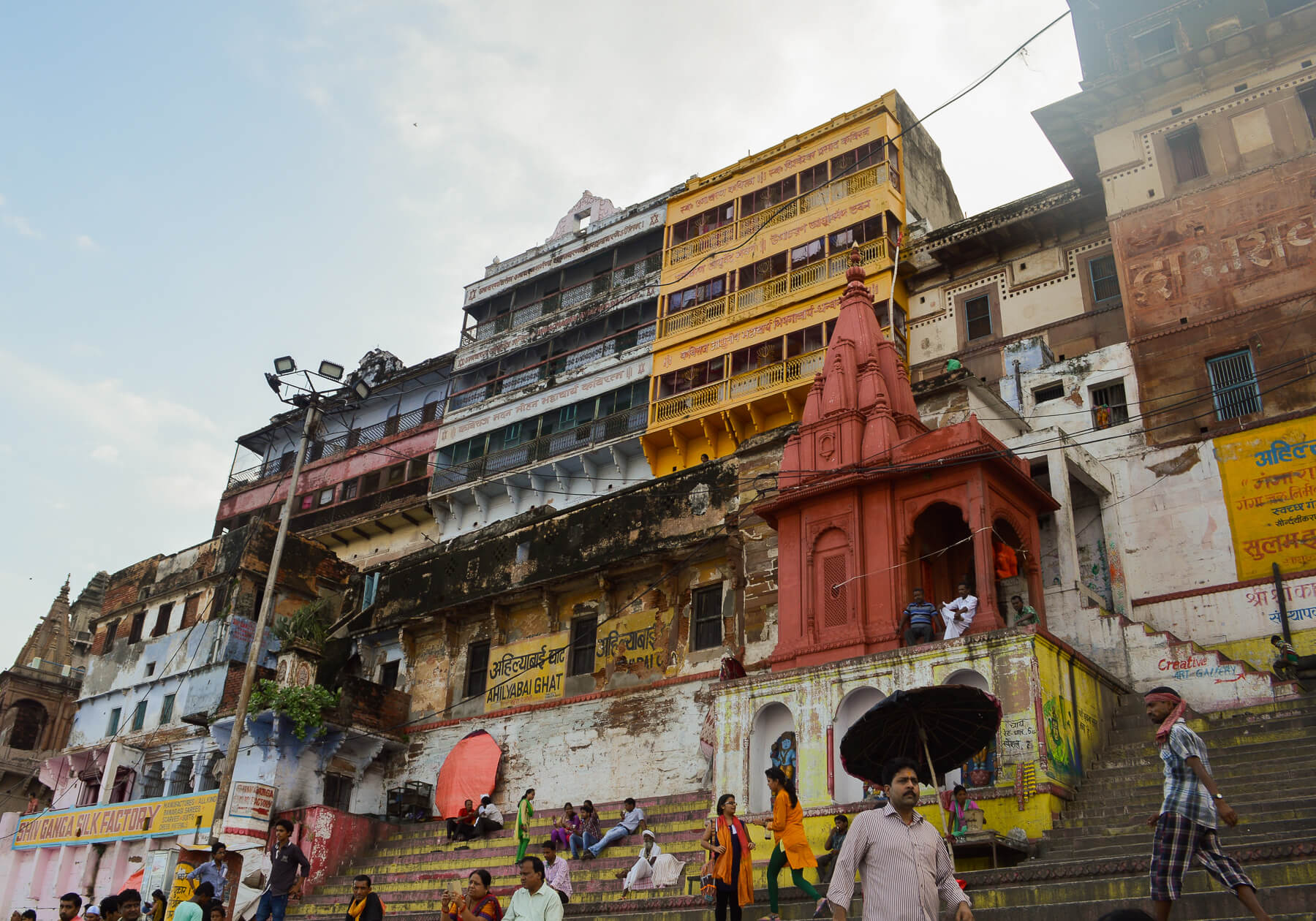 Old, rainbow buildings and temples along the Varanasi River