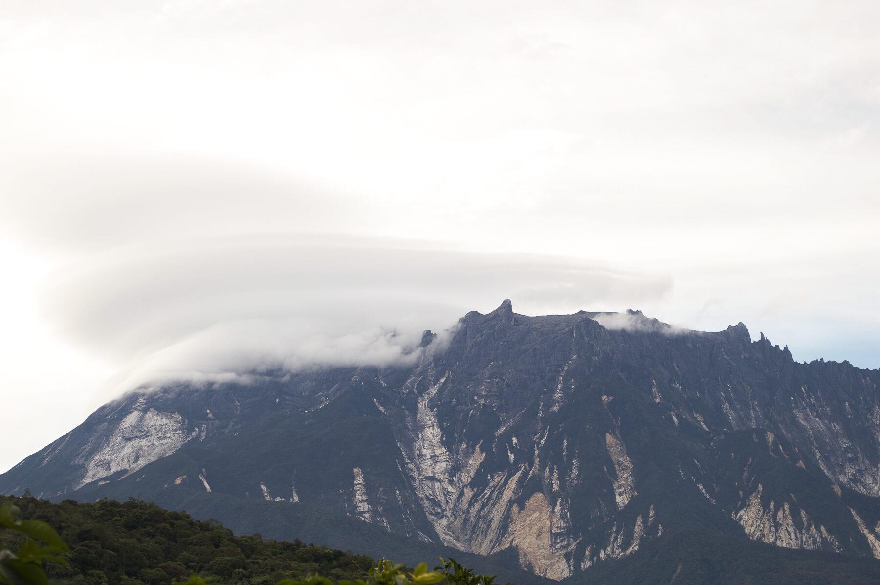 Clouds resting on peak of Mount Kinabalu