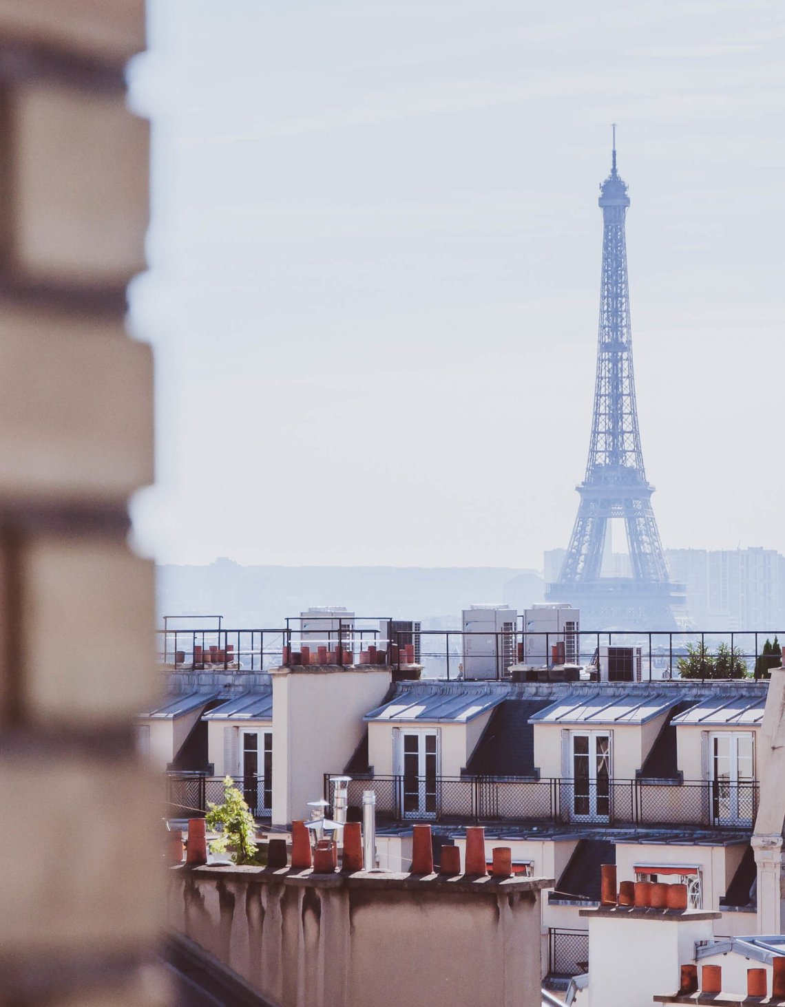 Distant Eiffel Tower from over the roof tops in Paris