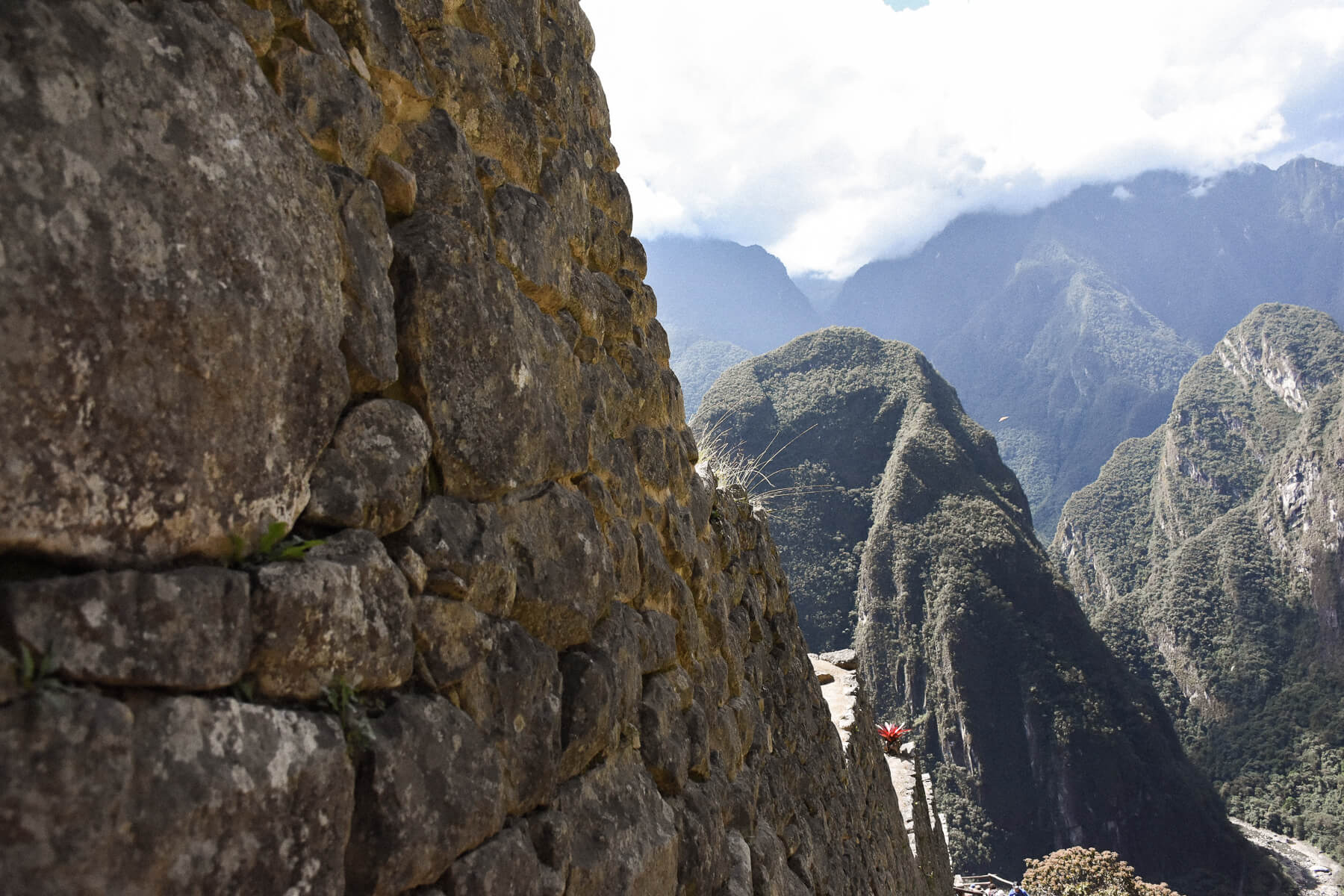 Focus of Stone wall with the protruding mountains rising from the earth behind it