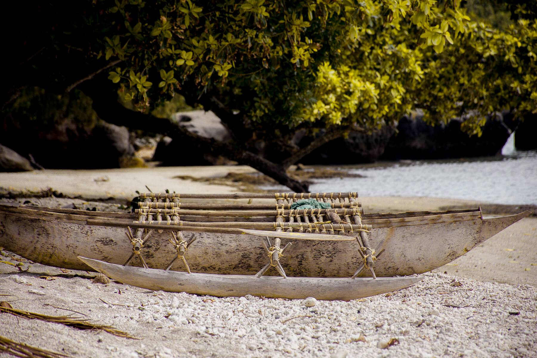 An old style canoe on the sandy beach