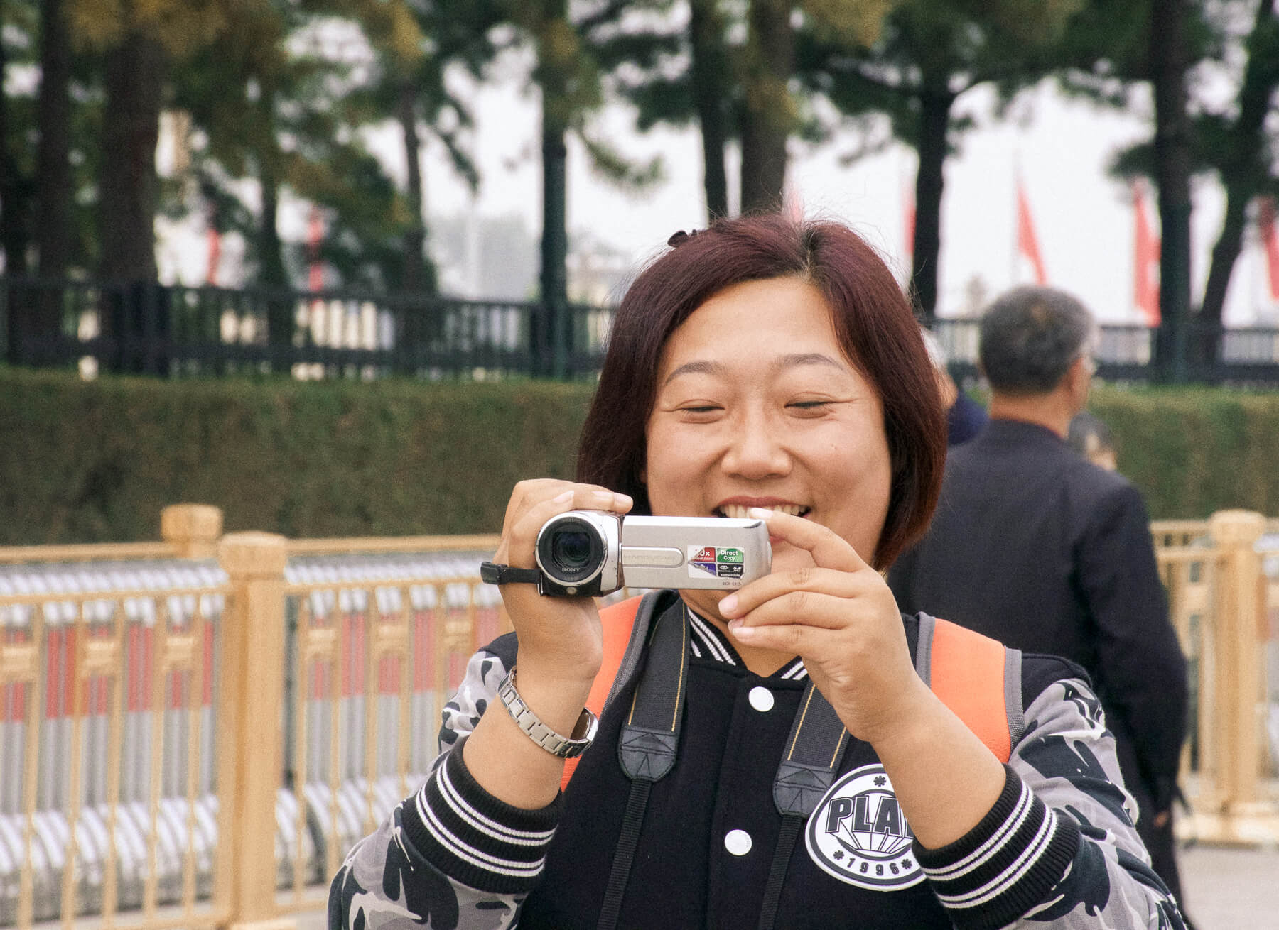 An image of a Chinese lady taking a picture of me with a hand held video-cam