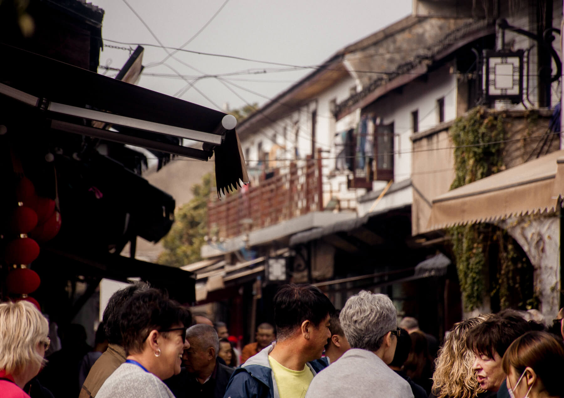 Locals and tourists walking the streets of the old city of Suzhou