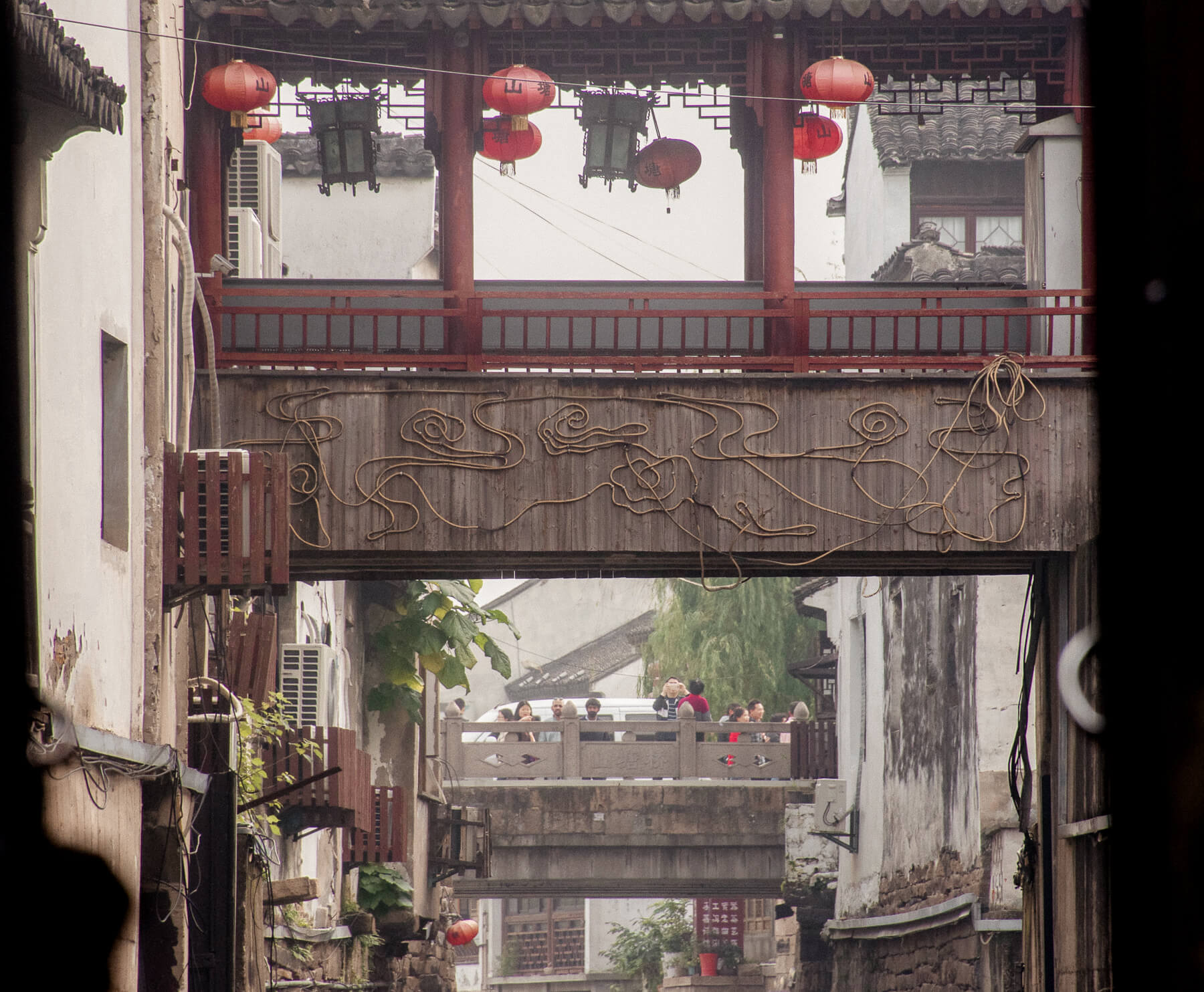 Looking down the Grand Canals of Suzhou under all the foot bridges