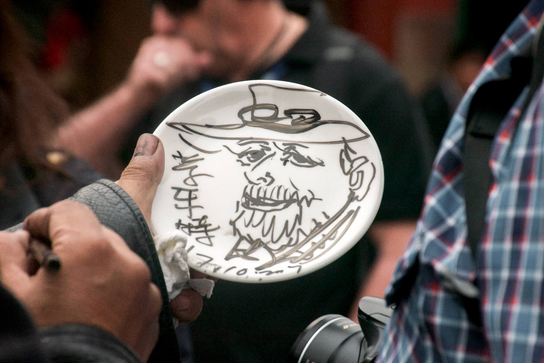 A hand drawn painting of a western tourist on a plate
