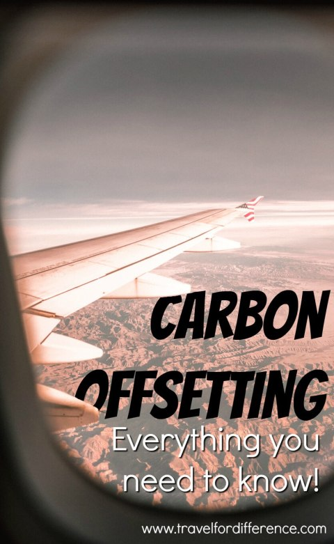 """Looking out a plane window at the wing and the mountains below with text overlay """"Carbon Offsetting - Everything you need to know"""""""