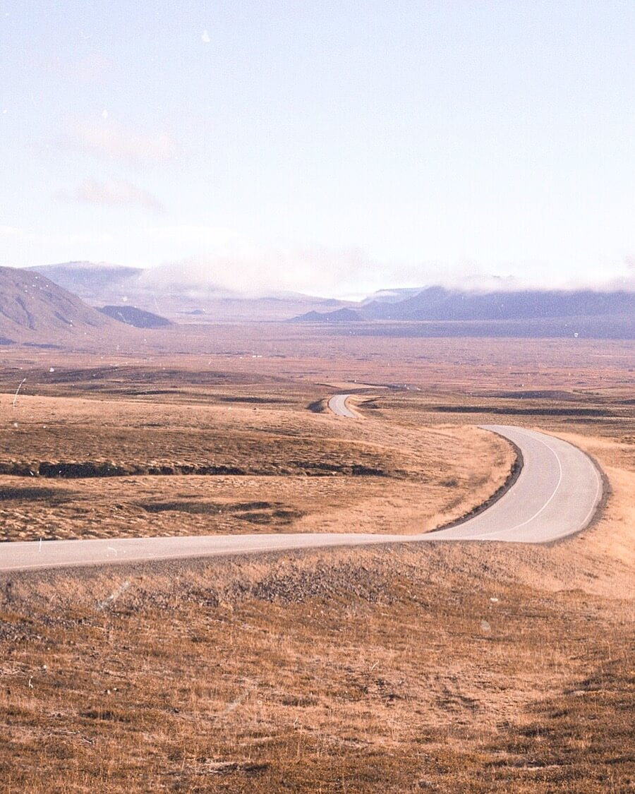Looking down the Iceland Ring Road in the middle of an open valley