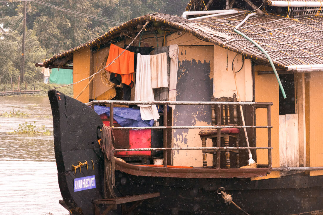 The back of a Alleppey Houseboat with washing drying on the back