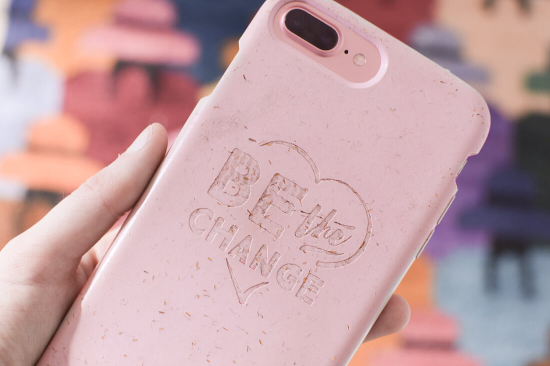 "Pink plastic free phone case with ""Be the Change"" printed in it."