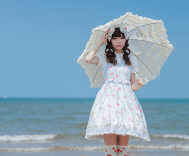 Picture shows a girl dressed in Lolita Style