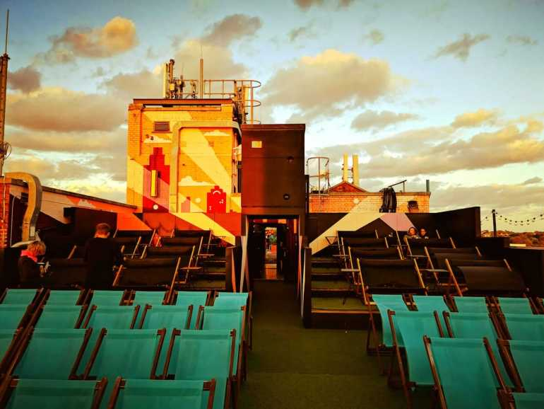 Rooftop Cinema at Bussey building- Love seats at the back of the seating area