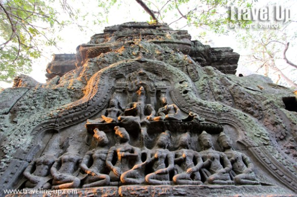 biking cambodia angkor archaelogical park ta prohm carvings