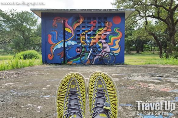 keen uneek sandals bike street art