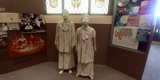 statues of school choir boys at boys town