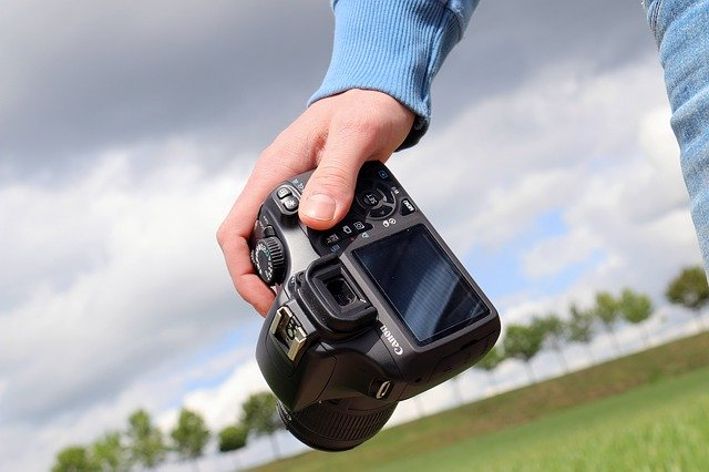 Tips for Creative Tourism Photography for Your Vacation man holding digital camera
