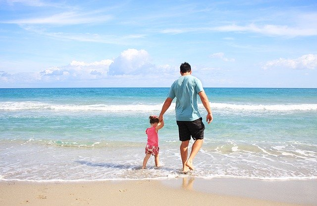 Beach Safety For Kids Tips kid with her dad