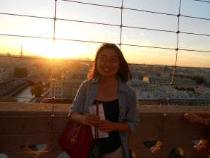 Author on top of the Notre Dame Cathedral towers in Paris