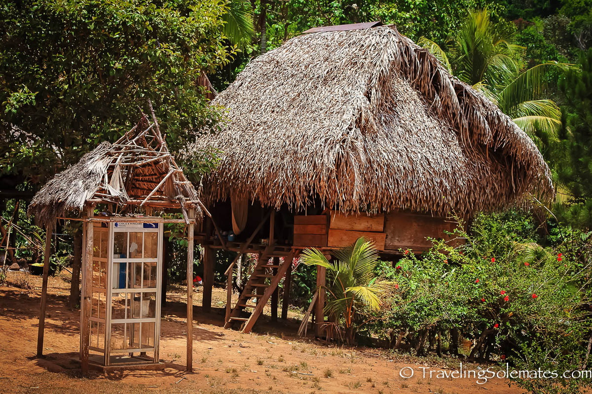 Stilt house and payphone in Embera Drua Village, Panama