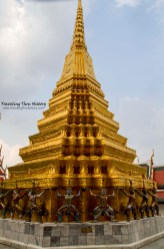 One of the two 'small' golden chedis behind Prasat Phra Thep Bidon being held up by Yaksa Tavarnbal (demon guardians). These chedis were built by Rama I. One is devoted to his father and the other is devoted to his mother.