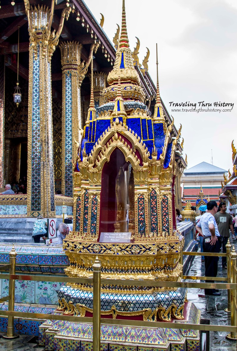 Six ornamental chedi surround the wall that encompasses the Temple of the Emerald Buddha. Three are blue and three are green.