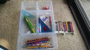 Container emptied out. On the right the crayons we kept.