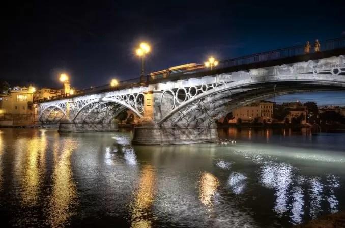 Triana Bridge Seville Spain e1554444068140 - Seville Tourist Guide | Best Places To Visit in Seville, Spain