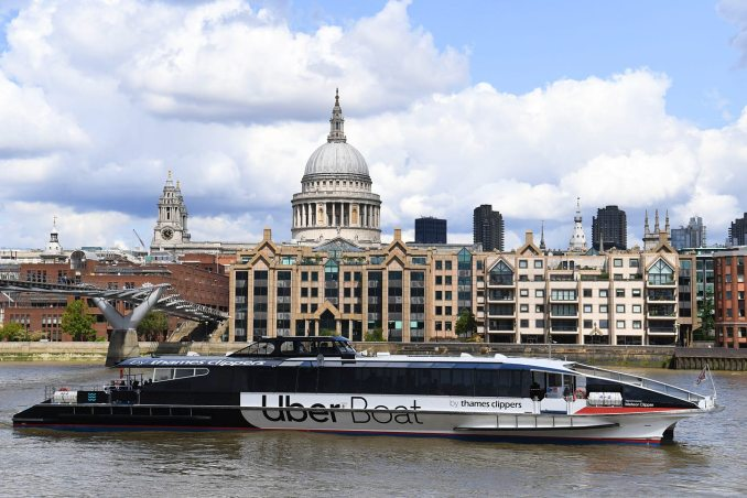 An Uber boat operated in partnership with Thames Clippers travels along the River Thames