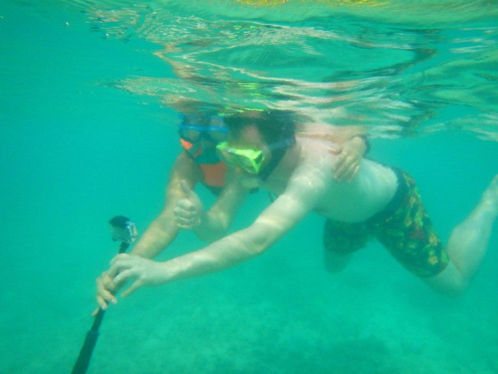I saw human couple in the marine life of Cadlao Island haha
