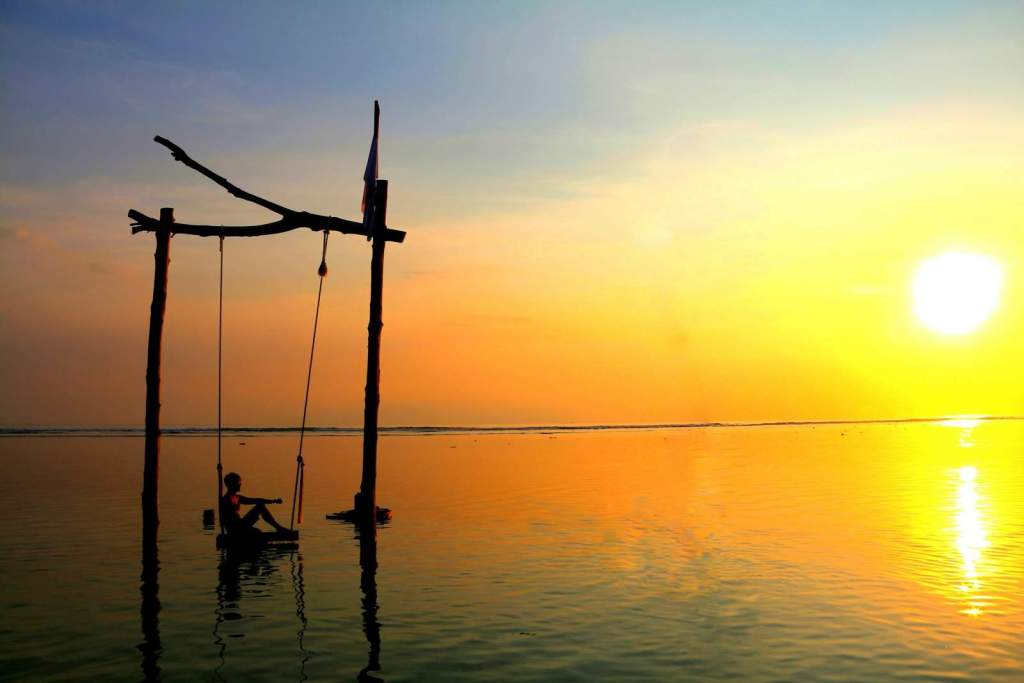 Sunset in Gili Islands at swing in the sea