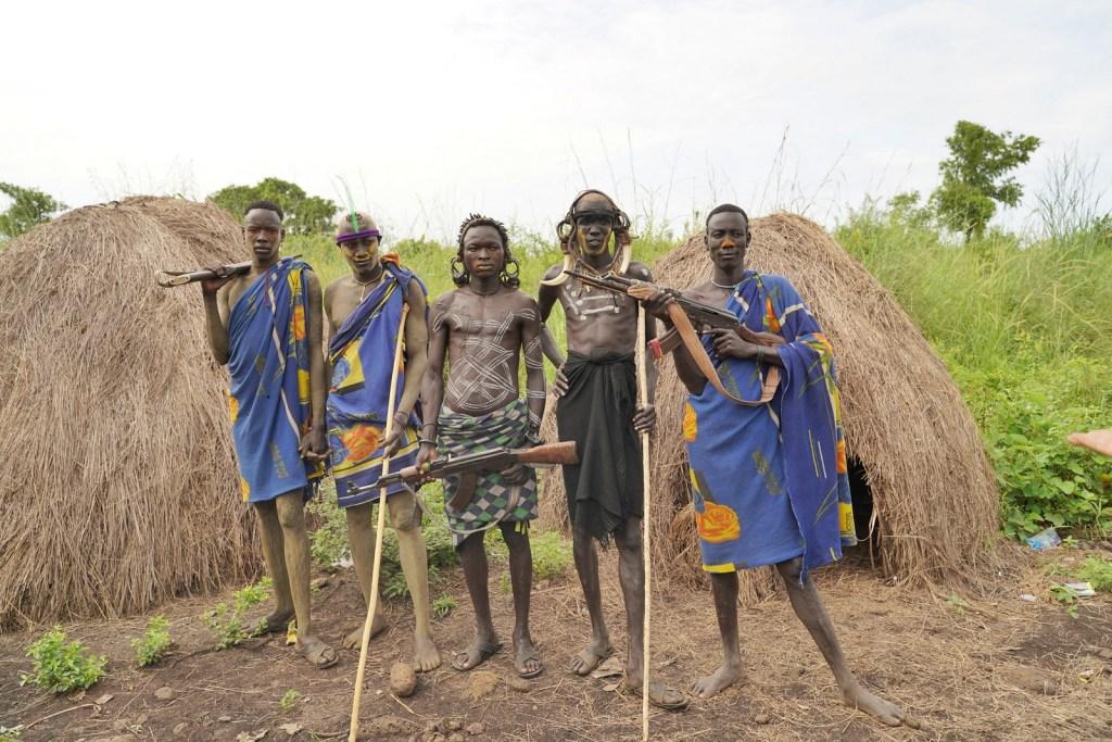 Mursi Tribe Men With Rifle