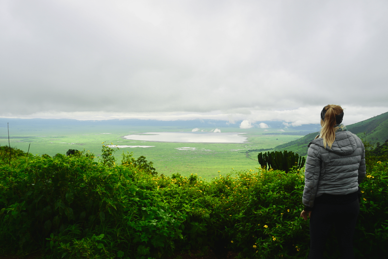 Travel Jael standing by the rim of the Ngorongoro Crater in Tanzania