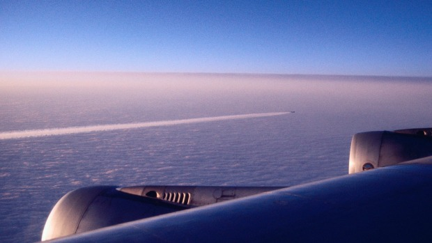 The variety of contrails seen in the sky is due to atmospheric conditions and altitude.