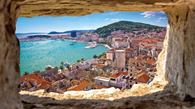 The azure waters of Split seen through a stone window in the region of Dalmatia, Croatia.