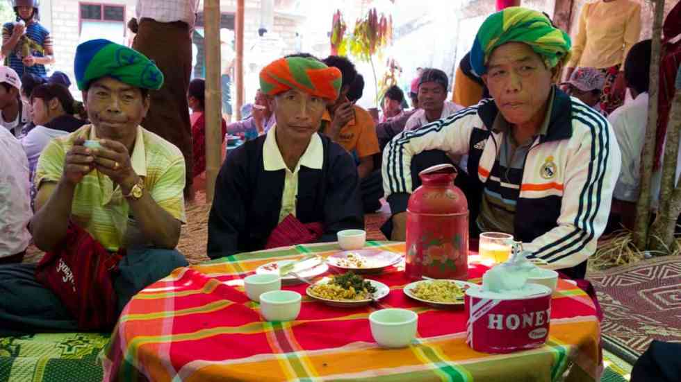 Families enjoying the feast, Novitiation ceremony, Myanmar