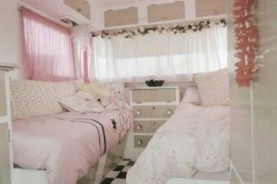 Retro pink bedroom in a caravan