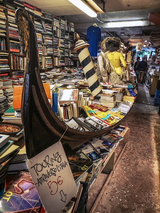 Libreria Acqua Alta Bookshop in Venice is the only bookshop in the world to have a gondola of floating books during acqua alta each winter.