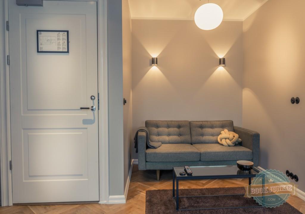 Cornflower blue sofa in apartment in Kvosin Downtown Hotel in Iceland