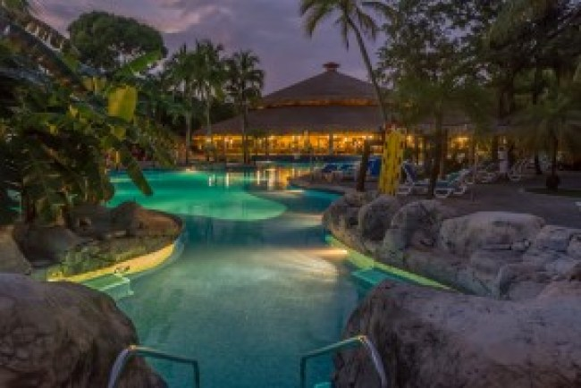 The pool area at night at the Riu Tequila, Plaacar Mexico