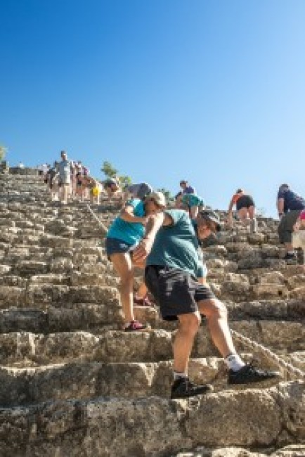 Climbing down the Nohoch Mul temple, Coba, Mexico