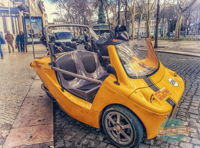 The yellow GoCar that is eco-firendly travelling around Lusbon in Prtugal